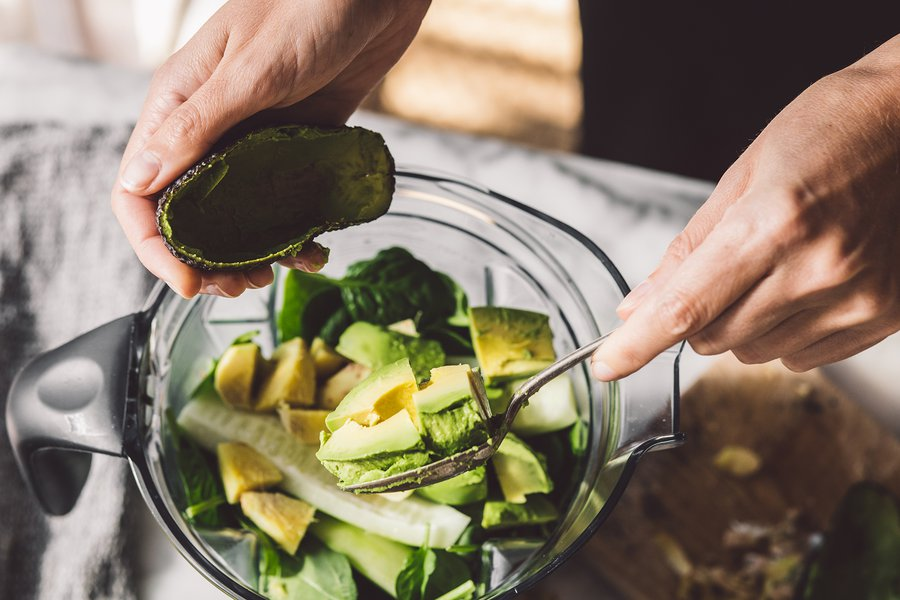 A vibrant avocado smoothie plus groceries for glowing skin